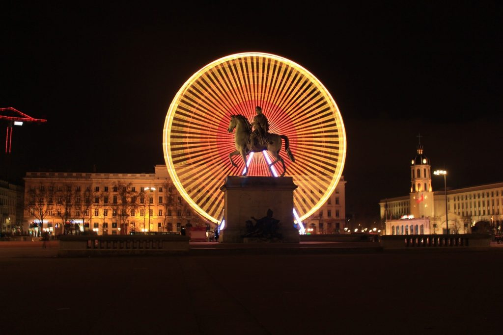 Place Bellecour illuminated by the Ferris wheel